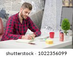 concentrated on work.... | Shutterstock . vector #1022356099