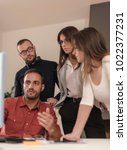 businessman by the desk in... | Shutterstock . vector #1022377231