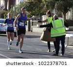 Small photo of Worthing, Sussex, UK; 11th February 2018; Runner in Worthing Half Marathon Accepting a Drink From a Volunteer Helper