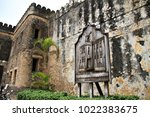 a sign on the wall of the old... | Shutterstock . vector #1022383675