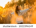 happy woman with open arm on... | Shutterstock . vector #1022396149