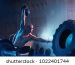 young man doing a weight... | Shutterstock . vector #1022401744
