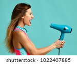 happy young brunette woman with ... | Shutterstock . vector #1022407885