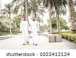 arabic businessmen in dubai | Shutterstock . vector #1022412124
