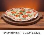 delicious italian pizza served... | Shutterstock . vector #1022413321