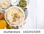 bowl of oatmeal with banana ... | Shutterstock . vector #1022415205