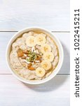 bowl of oatmeal with banana ... | Shutterstock . vector #1022415211