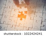 jigsaw with one piece missing... | Shutterstock . vector #1022424241