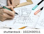 designer makes a sketch of the... | Shutterstock . vector #1022430511