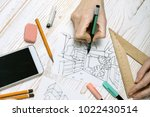 designer makes a sketch of the... | Shutterstock . vector #1022430514