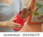 hands holding bamboo cylinder... | Shutterstock . vector #1022436175