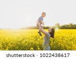 joyful woman walk on green... | Shutterstock . vector #1022438617