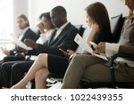 multi ethnic applicants sitting ... | Shutterstock . vector #1022439355