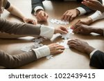 diverse business people helping ... | Shutterstock . vector #1022439415