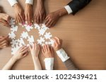 hands of multi ethnic team... | Shutterstock . vector #1022439421
