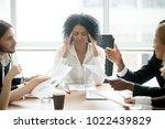 stressed overwhelmed african... | Shutterstock . vector #1022439829