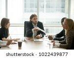 angry boss reprimanding female... | Shutterstock . vector #1022439877