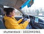 woman drive car in winter day... | Shutterstock . vector #1022441461