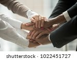 diverse people putting stacked... | Shutterstock . vector #1022451727