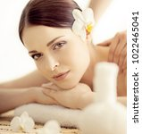 young and beautiful woman in spa   Shutterstock . vector #1022465041