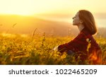 woman sits with her back in the ... | Shutterstock . vector #1022465209