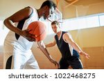concentrated sporty young... | Shutterstock . vector #1022468275