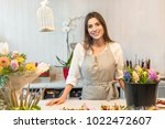 smiling woman florist small... | Shutterstock . vector #1022472607