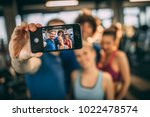 friends having fun at the gym.... | Shutterstock . vector #1022478574