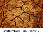 cracked clay ground into the... | Shutterstock . vector #1022484019