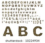 Complete alphabet where letters are made of on an old burnt parchment background - stock photo