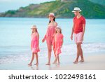 happy beautiful family on white ...   Shutterstock . vector #1022498161
