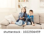 frightened children watching... | Shutterstock . vector #1022506459