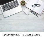modern workplace on wooden... | Shutterstock . vector #1022512291