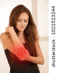 arm injury   active young woman ... | Shutterstock . vector #1022523244