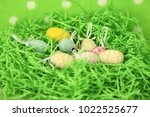 colorful easter eggs   happy... | Shutterstock . vector #1022525677