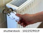 hand adjusting the valve knob... | Shutterstock . vector #1022529019