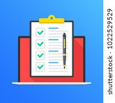 checklist on laptop screen.... | Shutterstock .eps vector #1022529529