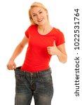 woman wears too big trousers as ... | Shutterstock . vector #1022531764