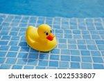 yellow rubber duck in blue... | Shutterstock . vector #1022533807