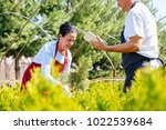 senior couple of gardeners or... | Shutterstock . vector #1022539684