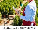 senior woman gardener or seller ...   Shutterstock . vector #1022539735