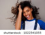 portrait of smiling young woman ... | Shutterstock . vector #1022541055