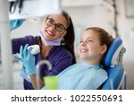 female dentist talk about... | Shutterstock . vector #1022550691