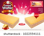 creamy wafer ads. milk splashes.... | Shutterstock .eps vector #1022554111