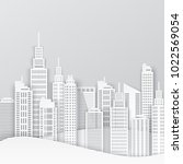 white paper skyscrapers.... | Shutterstock .eps vector #1022569054