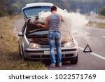the car broke down  smokes from ...   Shutterstock . vector #1022571769