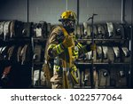 Firefighter With Gear In Front...