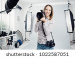 young female photographer... | Shutterstock . vector #1022587051