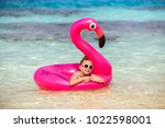 adorable little girl with pink... | Shutterstock . vector #1022598001