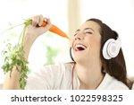cheerful girl wearing...   Shutterstock . vector #1022598325